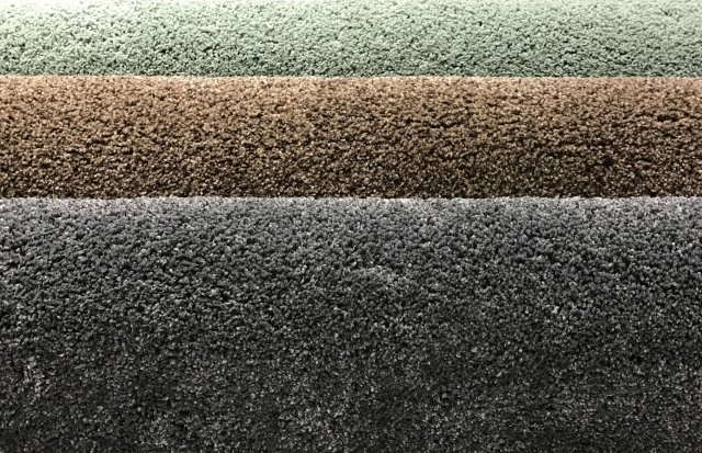 Green, brown and dark grey carpet samples