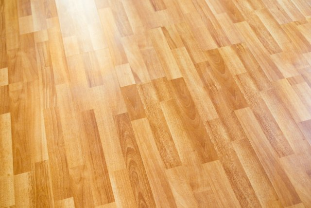 Light brown/tan wood grain flooring