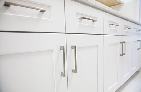 White cabinets with silver rectangular handles