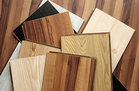 Various rectangular samples of wood flooring in different shades of brown