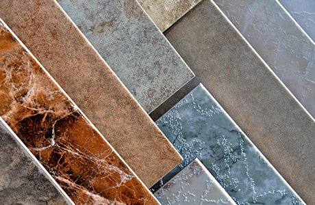 Various colors and patterns of porcelain tiles lined up in parallel