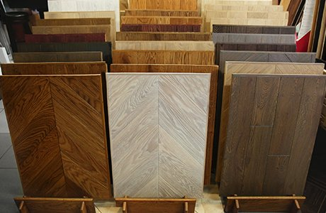 Dozens of vinyl flooring samples lined up, with many different colors and textures