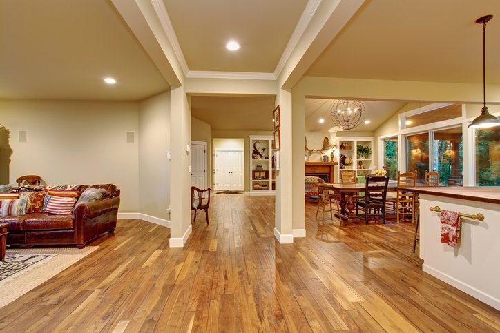 House with open floor plan, with light wood flooring, The dining room and living room are shown