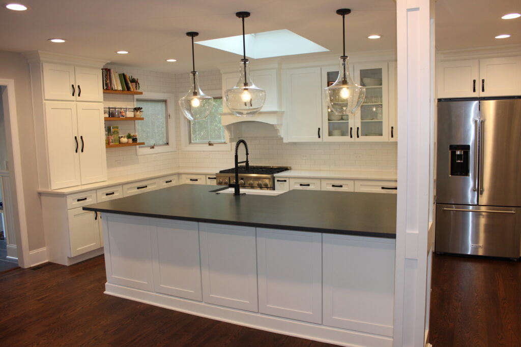 Fully remodeled kitchen with white cabinets, black accents and stainless appliances