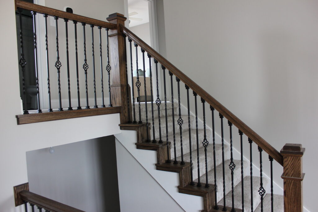 Custom stairwell with dark wood and black railings