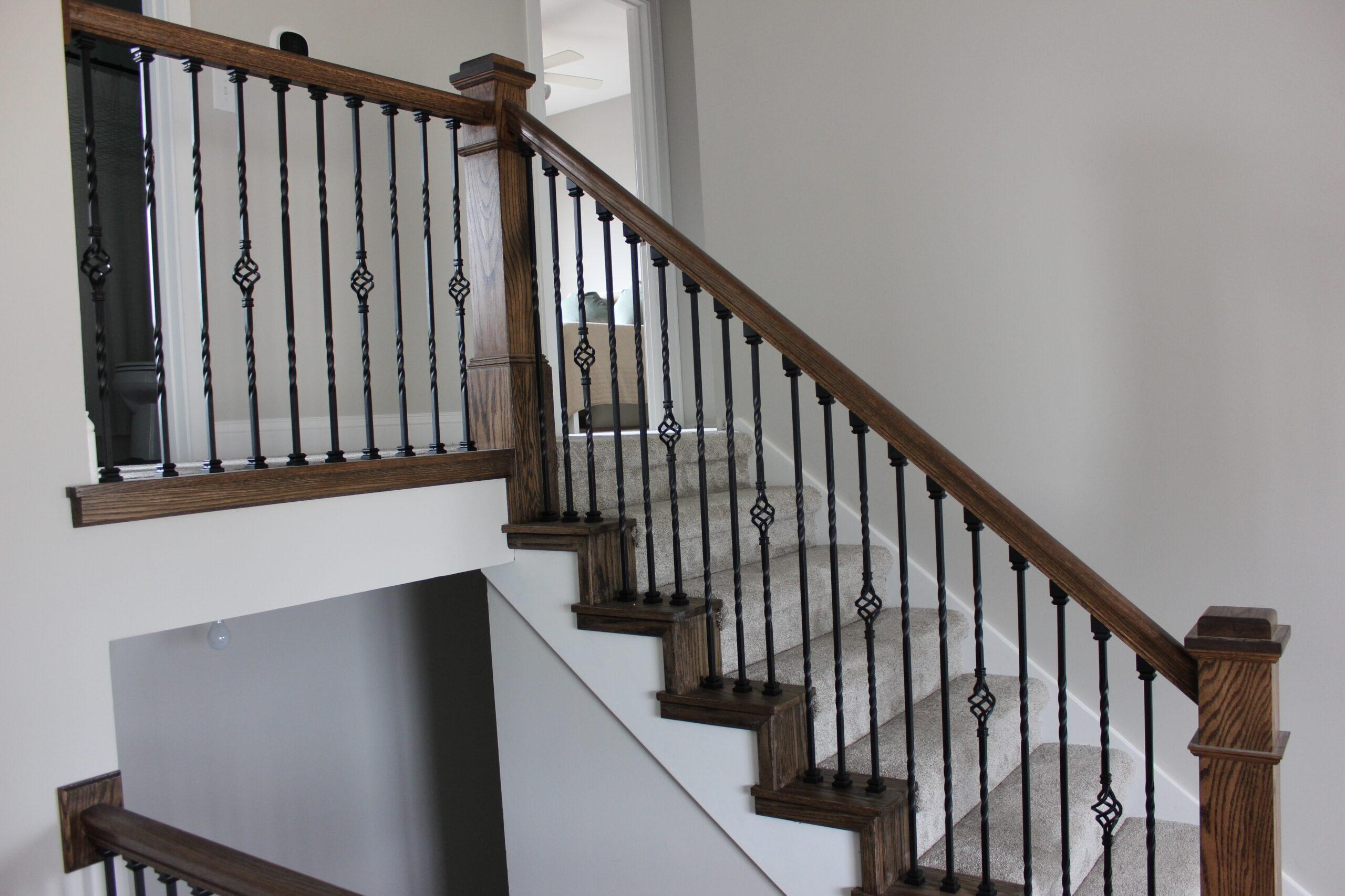 Custom stairwell with dark wood and black railings