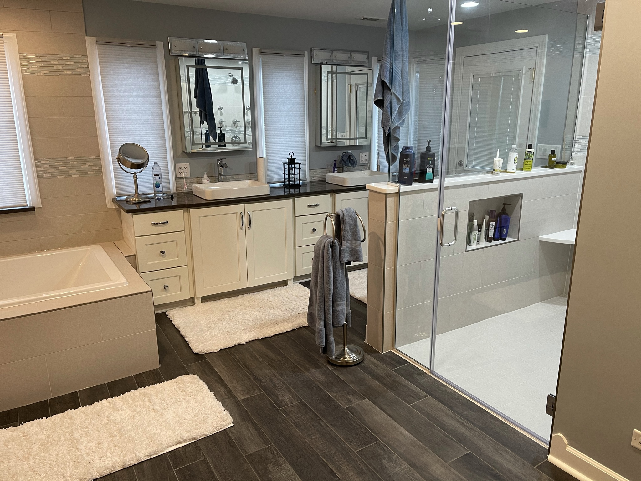 Bathroom with custom glass door, walk-in shower and a custom square tub